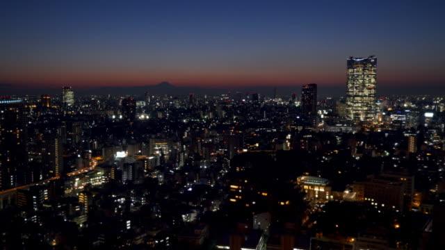 mt fuji and tokyo nightscape at dusk - 都市景観点の映像素材/bロール