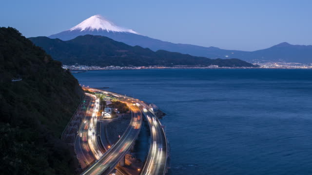 mt. fuji and traffic driving on the tomei expressway, shizuoka, honshu, japan - mt fuji stock videos & royalty-free footage