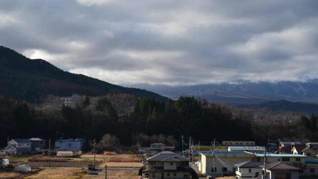 mt. fuji over a village in the countryside of japan - jp201806 stock videos and b-roll footage