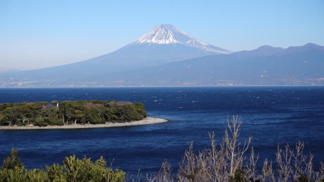 mt. fuji over the ocean from cape oosezaki - shizuoka prefecture stock videos and b-roll footage