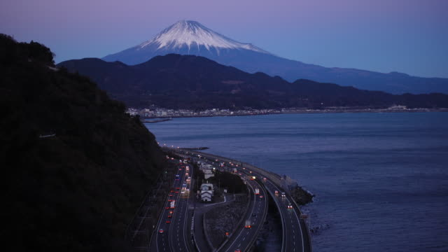mt. fuji over the suruga bay and tomei expressway (video) - shizuoka prefecture stock videos and b-roll footage
