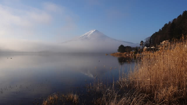Mt. Fuji Reflected in Lake Kawaguchi in a Foggy Morning