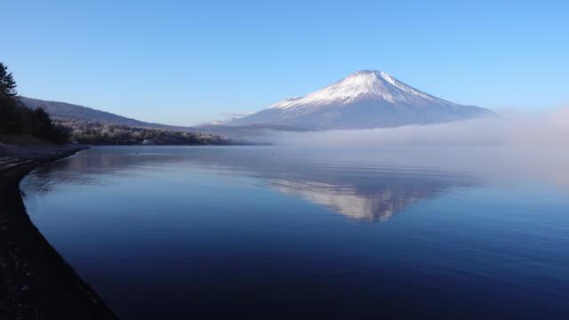 Mt. Fuji Reflected in Lake Yamanaka in a Foggy Morning