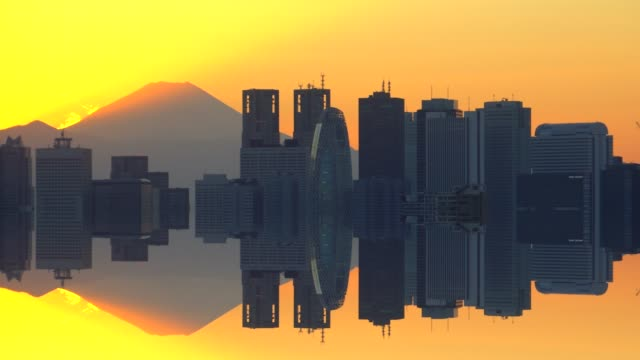 Mt. Fuji with the city building before sunset - mirror