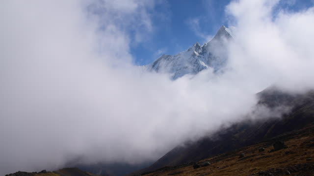 Mt. Machapuchare and clouds from Annapurna Base Camp ,Nepal.