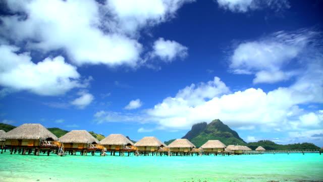 mt otemanu overwater bungalows aquamarine lagoon bora bora - polynesian ethnicity stock videos & royalty-free footage