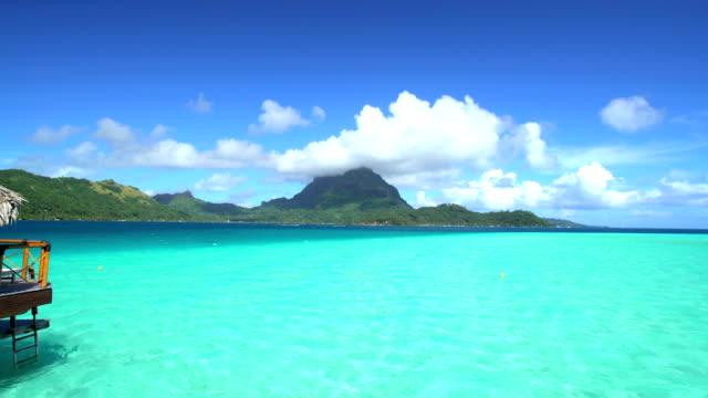mt otemanu overwater bungalows aquamarine lagoon bora bora - polynesischer abstammung stock-videos und b-roll-filmmaterial