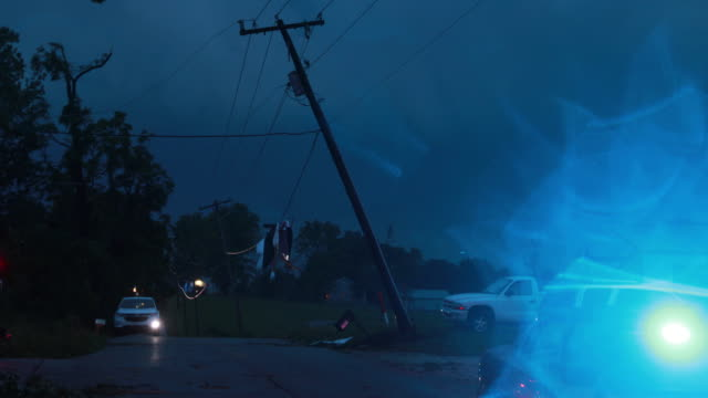 mt tabor road is shut down by police because of downed power lines after an ef-1 tornado with 130 mph winds made an 8.22 mile path saturday, june 15,... - power line stock videos & royalty-free footage