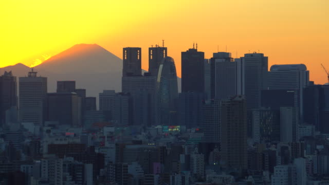 mt.fuji with the city building before sunset - mt fuji stock videos & royalty-free footage