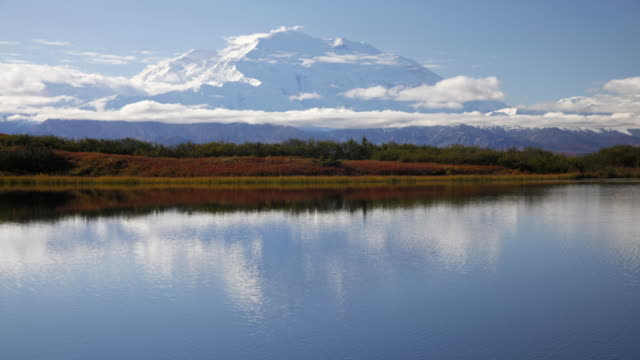 mt.mckinley's image shifts and changes in reflection pond, denali national park, alaska. - denali national park stock videos & royalty-free footage