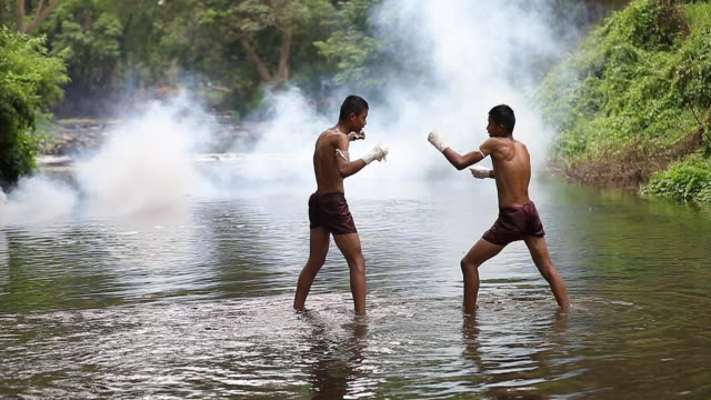 muay thai or thai boxing running slow motion at thailand - muay thai stock videos and b-roll footage