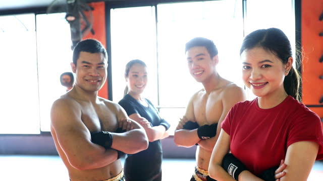 Muay Thai workout - Training at the gym facility - Portraits