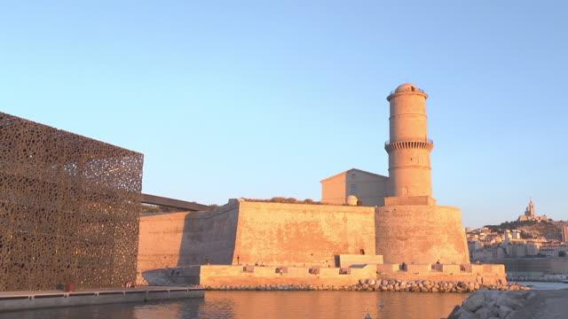 vidéos et rushes de mucem with latern tower / fort saint jean - sunset - marseille
