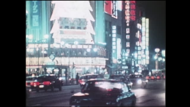 much of the ginza remains brightly lighted during the oil crisis as traffic speeds past. - showa period stock videos & royalty-free footage
