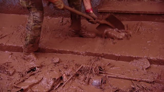 Mud and debris being cleared from the streets after a devastating flash flood in Mallorca Spain