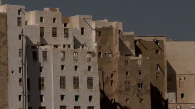 mud brick high rises fill the town of shibam yemen. - yemen stock videos and b-roll footage