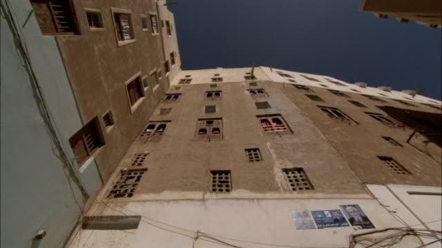 mud brick high rises tower over shibam yemen. - yemen stock videos and b-roll footage