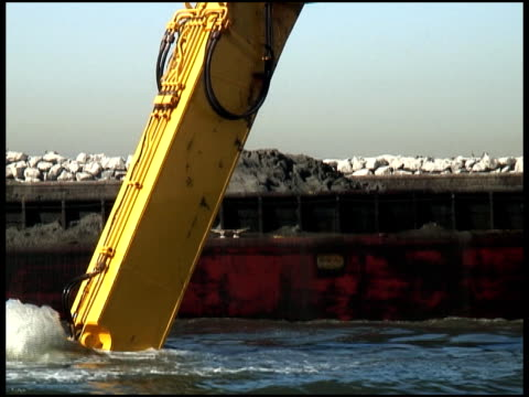 mud dredged, dug, scooped -- and dropped, dumped on barge - hydraulics stock videos and b-roll footage