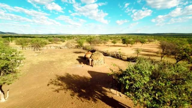 heli mud huts in the himba village - africa stock videos & royalty-free footage