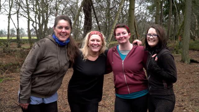 Mud Run Women's team looking at camera - Slow Motion