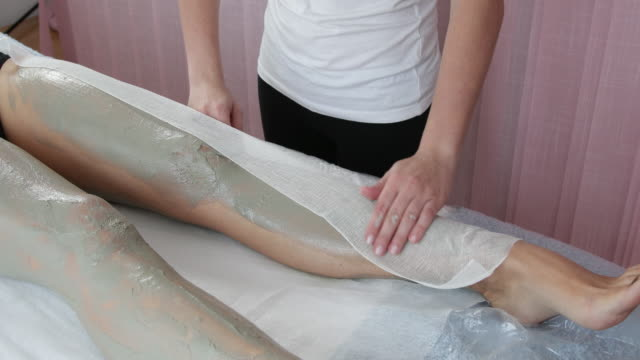 Mud treatment of legs in spa