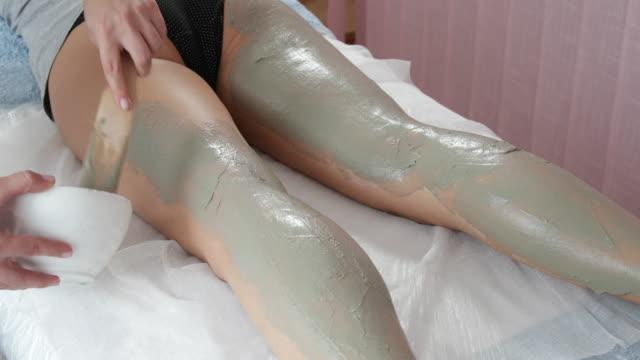 Mud treatment on both legs