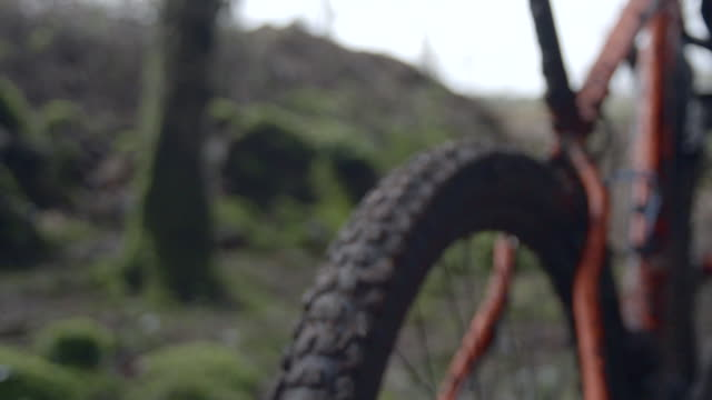 muddy details of a man mountain biking in the woods. - super slow motion - filmed at 240 fps - mountain bike stock videos and b-roll footage