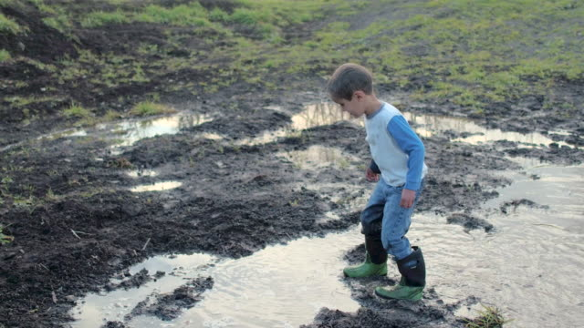 muddy puddles - primary age child stock videos and b-roll footage