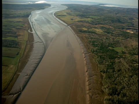 Muddy river flows out to Bay of Fundy.