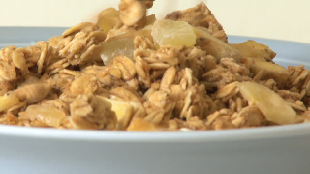muesli being poured into bowl - cereal plant stock videos & royalty-free footage