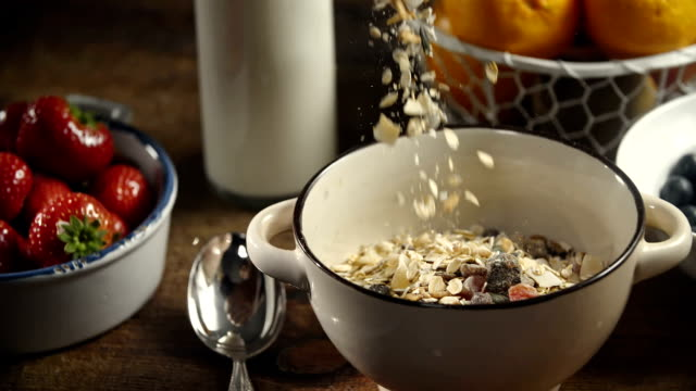 muesli cereals falling into bowl - protein bar stock videos & royalty-free footage