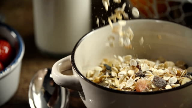 muesli cereals falling into bowl - breakfast cereal stock videos and b-roll footage