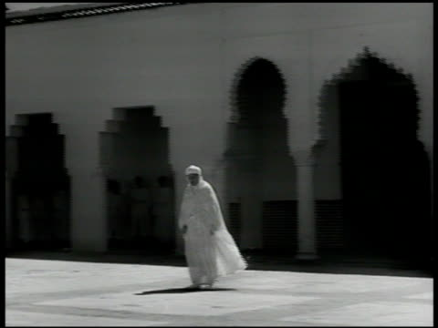 muezzin leading the adhan from balcony of masjid minaret sultan muslim islamic leader sidi muhammad v walking alone in courtyard of majid - sultan stock videos and b-roll footage