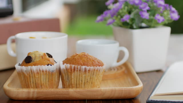 muffin cake and gen food with black coffee breakfast set on wooden dish and wooden table, dolly shot right to left - brunch stock videos and b-roll footage