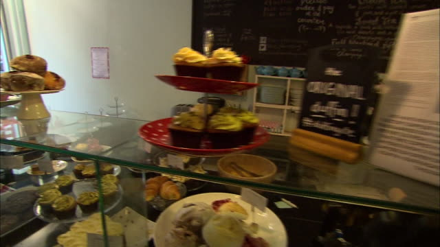 stockvideo's en b-roll-footage met muffins are on display at a bakery. - healthcare and medicine or illness or food and drink or fitness or exercise or wellbeing
