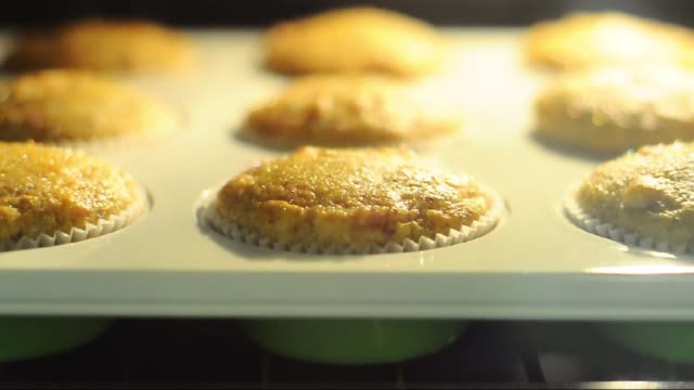 muffins in the oven - fresh baked salty muffins - muffins growing in the oven - cream cake stock videos & royalty-free footage