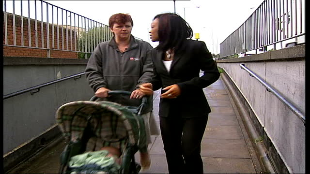 muggers threaten baby; england: essex: basildon: ext reporter along into underpass with mugging victim leesa georghoudis who is pushing her baby in a... - basildon stock-videos und b-roll-filmmaterial