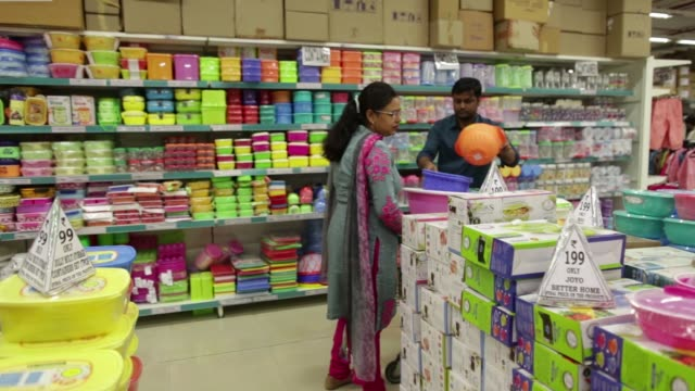 CU mugs hang on display at a DMart supermarket operated by Avenue Supermarts Ltd in Thane Maharashtra India on Saturday Feb 13 A shopper browses...