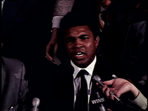 muhammad ali and joe frazier cause a ruckus at a press event leading up to the the fight of the century muhammad ali riles up press with victory... - 1971 stock videos & royalty-free footage