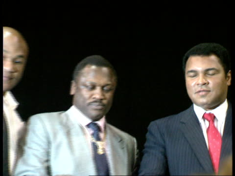 muhammad ali and other boxing legends attend london arena press conference **** some wembley london arena s arrivals for pkf george foreman joe... - mike tyson boxer stock videos and b-roll footage