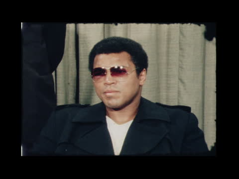 muhammad ali at london airport; england: london: lap : int muhammad ali interview sof: : - it's hard to say........ be lower: ekt: 16mm:... - itv news at one stock videos & royalty-free footage