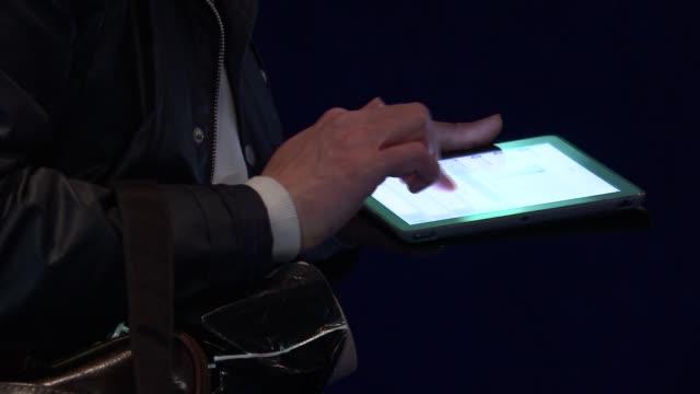 exhibition at the o2 man using tablet device / bathrobe on display - bathrobe stock videos & royalty-free footage