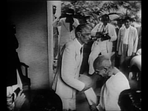 Muhammad Ali Jinnah leader of the AllIndia Muslim League greets Mohandas K Gandhi as he arrives at Jinnah's Bombay home to discuss partition of India...