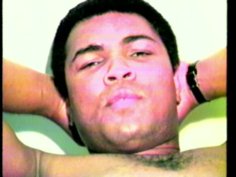 muhammad ali lying on doctor's bed speaking during visit to doctor's office, saying, ' tell the world that they haven't heard the last of muhammad... - anno 1975 video stock e b–roll
