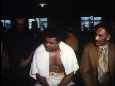 muhammad ali talks to reporters at a gym about how he feels as he prepares for his championship fight against joe frazier. - healthcare and medicine or illness or food and drink or fitness or exercise or wellbeing stock videos & royalty-free footage