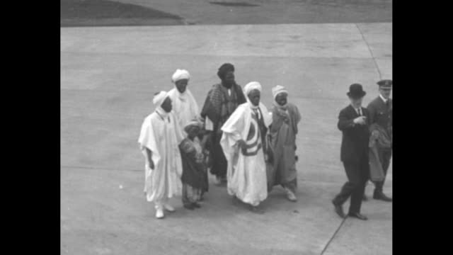 muhammadu dikko emir of katsina walks on tarmac of airfield with members of his family including his young grandsons at raf north weald accompanied... - the center stock videos and b-roll footage