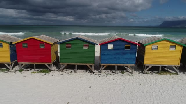 muizenberg beach huts and sea aerial view, south africa - beach house stock videos & royalty-free footage