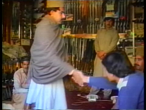mujahideen rebels shop for weapons in pakistan as the soviet-afghan war continues. - (war or terrorism or election or government or illness or news event or speech or politics or politician or conflict or military or extreme weather or business or economy) and not usa stock videos & royalty-free footage