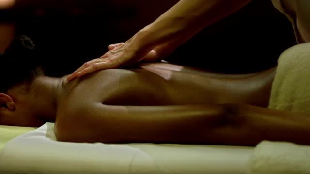 Mulatto Woman Enjoying A Back Massage