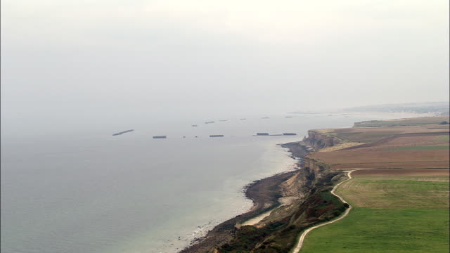 mulberry harbour - aerial view - lower normandy, calvados, arrondissement de caen, france - d day stock videos and b-roll footage